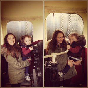 Mummy and Oliver driving a steam engine.