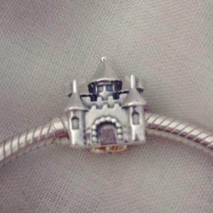 Castle and crown Pandora charm.