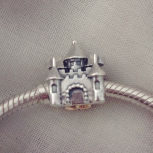 Castle and crown Pandora charm.
