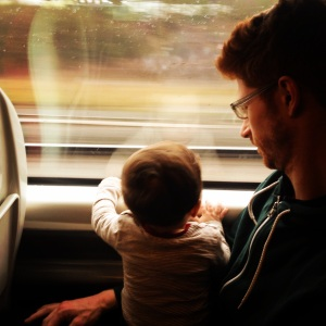 Daddy and Oliver watching the world go by.