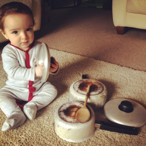 Oliver playing with pots and pans.