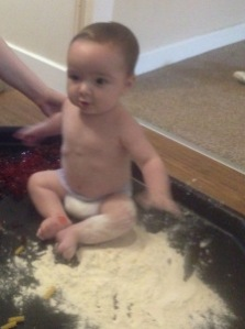 Oliver loves messy play with his friends.