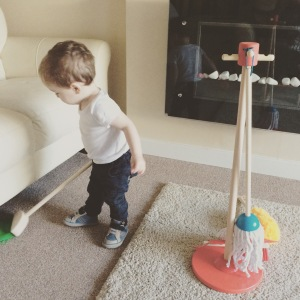 Oliver with his Melissa & Doug cleaning set.