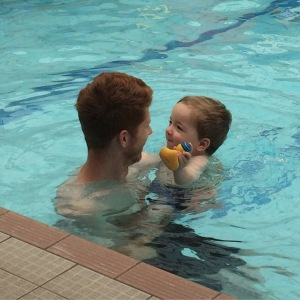 Daddy and Oliver at Oliver's swimming lesson.
