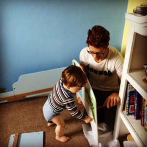 Oliver helping Daddy build his new toddler bed.