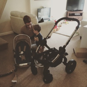 Daddy and Oliver building the new pram.