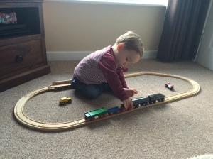 Oliver playing with Daddy's old train set.