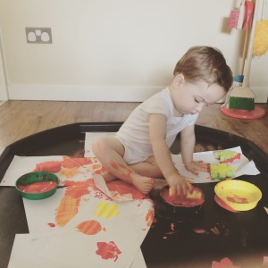 Oliver painting with leaf sponges.