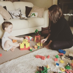 Mummy and Oliver playing with Mummy's old Duplo set.