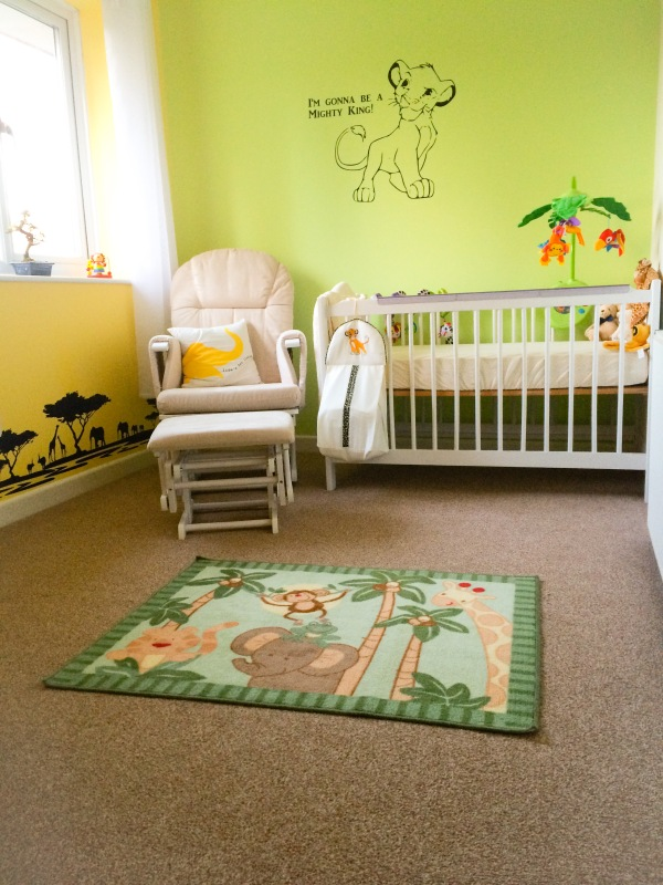 Curtains by Dunelm.  Cot Mobile by Fisher Price.  Lion King (Simba) nappy stacker by Drape Expectations.  Rocking chair and cushion by Mothercare.