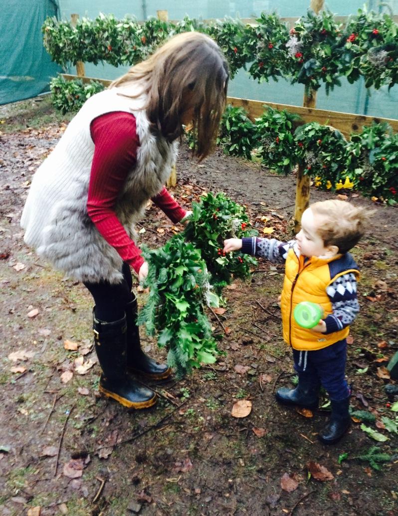 Oliver choosing a holly wreath