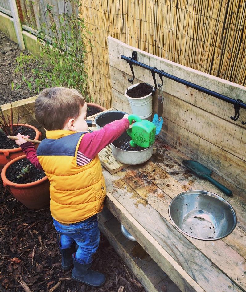 Mud kitchen in children's sensory garden